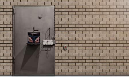 Temporary detention facility with a metal door with a brick wall. The concept of imprisonment for lawbreakers. A door with an open small window. Background with place for text.