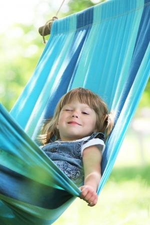 little girl on a hammock