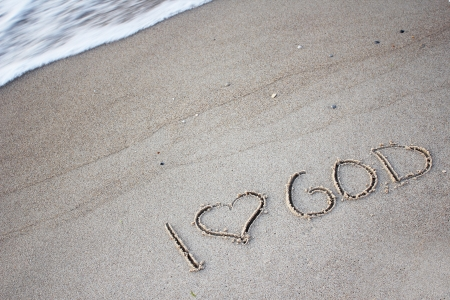 the words  I love God  in the sand photo