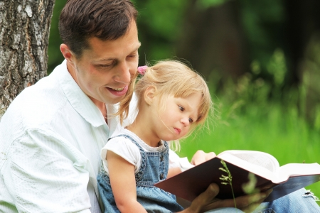 reading bible: Father and daughter reading the Bible Stock Photo