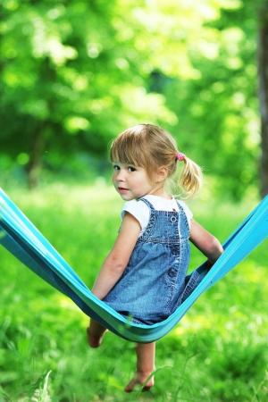little girl on a hammock photo