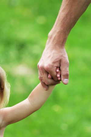 hand holds the hand of a parent child Stock Photo - 14245530