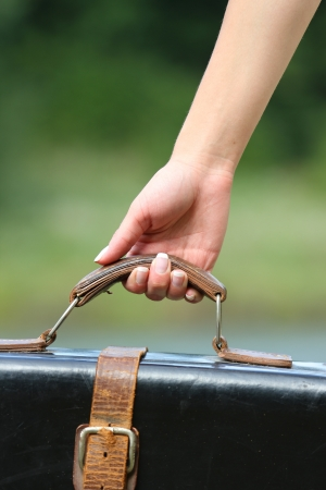 hand of a young woman with a suitcase Stock Photo - 14273936