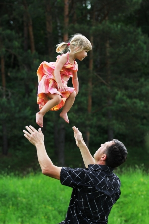 Beautiful little girl with her father on the nature Stock Photo - 14381635