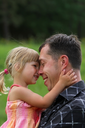 Beautiful little girl with her father on the nature Stock Photo - 14381639