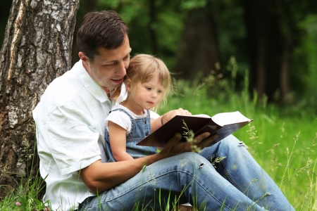 people in church: father and daughter reads the Bible