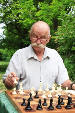 man playing chess photo