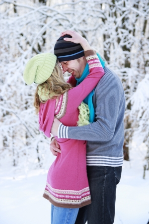 a young couple in love in the park in winter photo