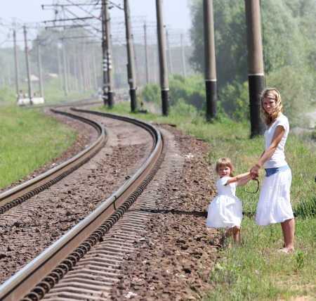 railroad and a young mother with her daughter photo