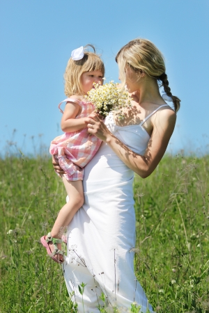 Mum and her little daughter on nature Stock Photo - 17799174