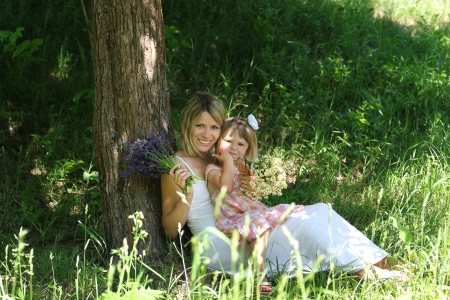 young mother and her little daughter on nature Stock Photo - 17799161