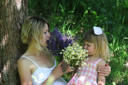 young mother and her little daughter on nature Stock Photo - 17799156