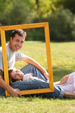 a young couple in love in the frame photo