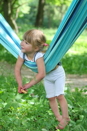 a very beautiful little girl on a hammock photo
