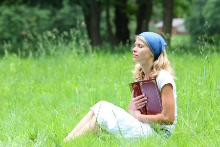 a young girl reads the Bible