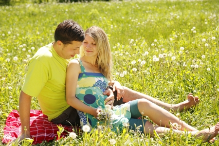 couple in love outdoors with a bouquet of flowers photo