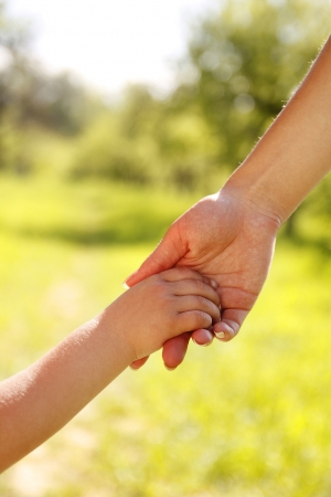 parent holds the hand of a small child Zdjęcie Seryjne