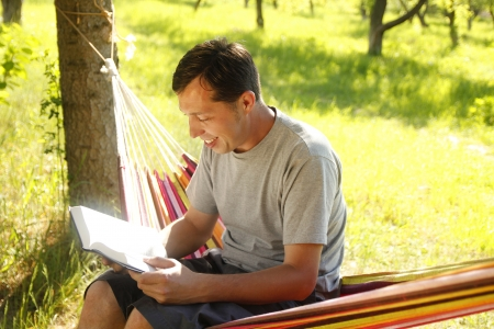 bible reading: a young man reading the Bible Stock Photo