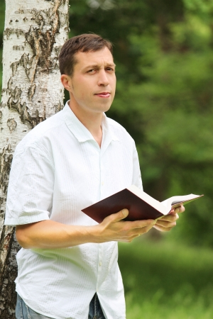 a young man reading the Bible photo