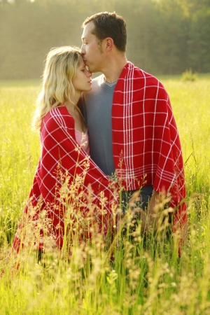 couple in love outdoors on a field photo