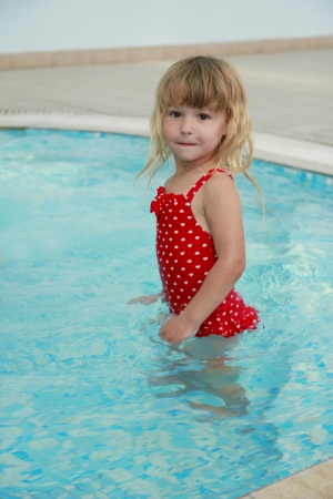 a little girl in the water pool photo
