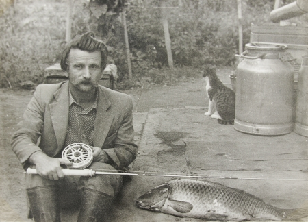 ancestors: a old vintage photo man with a fishing rod Stock Photo