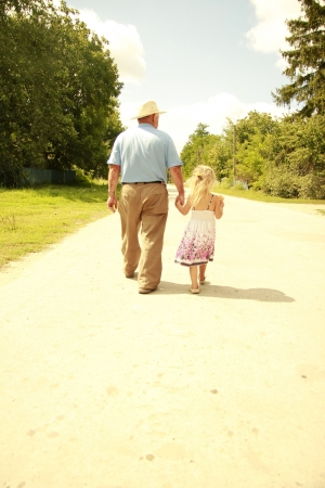 a Grandfather and granddaughter are on the road photo