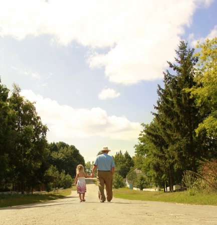 a Grandfather and granddaughter are on the road