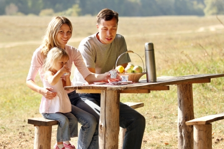 a Young family having a picnic in nature photo