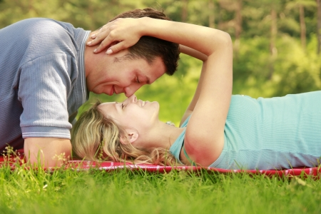 a Young beautiful couple in love outdoors photo