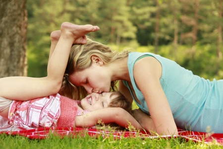 a young mother and her little daughter playing on grass Stock Photo - 22168025