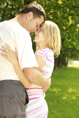 a Young couple in love outdoors photo