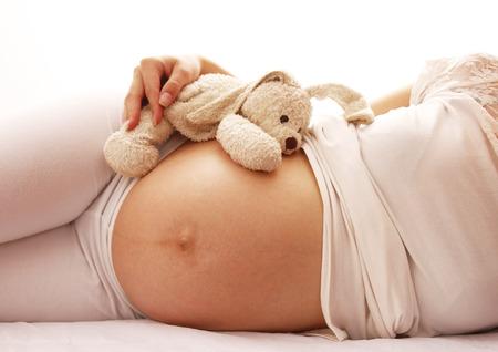 pregnant woman: a pregnant woman on a white background  Stock Photo