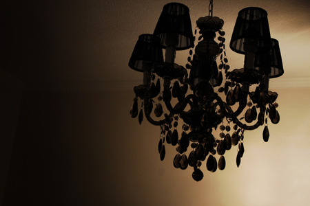 a chandelier on dark photo