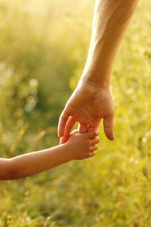 a parent holds the hand of a small child Zdjęcie Seryjne