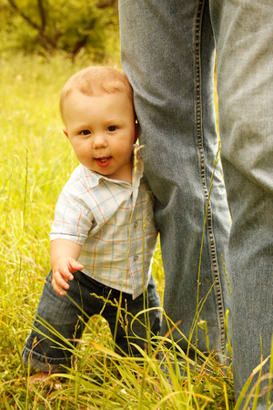 a little boy with his father on the nature photo