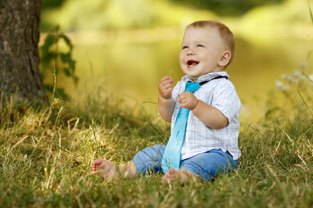 one family: a little boy playing in nature