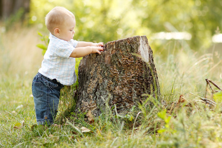 a little boy playing in nature