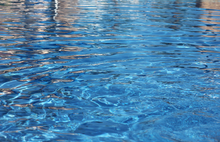 clean water: a blue water in the pool and near the background