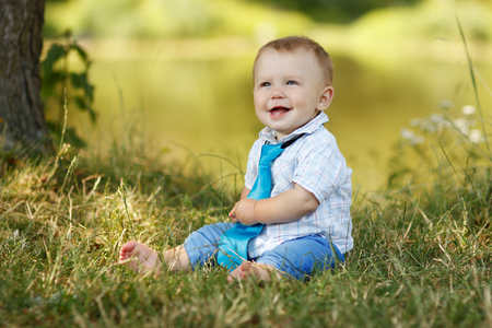 children laughing: a little boy playing in nature