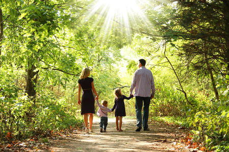 young family walk together on the nature Zdjęcie Seryjne