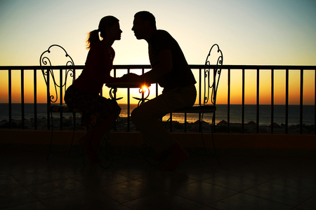 Silhouette of couple in love  near at sea photo