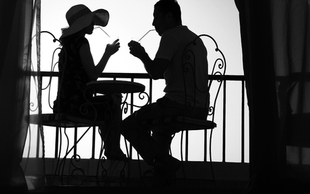 nice Silhouette of couple in love drink a drink photo