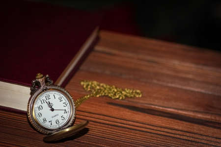 pocket watch with book background