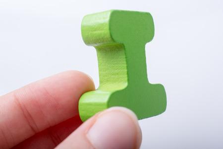 Hand holding Letter cube of I of  Alphabet