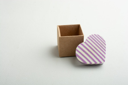 Love concept with heart shaped icon and a box  in view