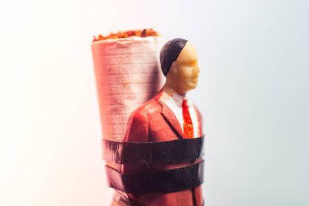 Man figurine tied to a cigarette as anti smoking  concept