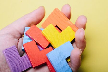Piece of wooden colorful  puzzle as problem solving concept