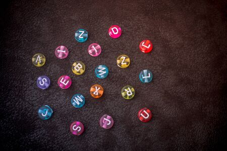 Multi color alphabet letter beads scattered randomly