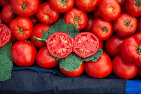 Fresh cut tomato at grocery store for food backgrounds concept